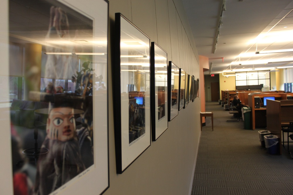 The long expansive wall of photographs.